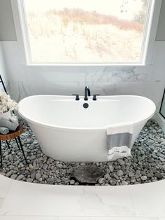 Freestanding tub surrounded by river rock Bathroom with Freestanding tub surrounded by river rock Freestanding tub surrounded by river rock Bathroom with Freestanding tub surrounded by river rock #Freestandingtub #riverrocktub #Bathroom #tub #riverrock