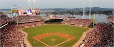 Great American Ballpark. Cincinnati, OH - home of the Reds and a very cool and underestimated ballpark. The view is great, with the water, steamboats, and rolling hills - takes you back in time. The steamboat stacks in the outfield are very cool. And the Skyline chili dogs that are served are my favorite ballpark food I've ever had!