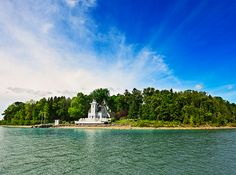 Round Island Lighthouse home and private island. Up for grabs: A remodeled historic Michigan lighthouse and an entire island to call your own. Real Estate Photographer, Beach Town, Lake Michigan, Michigan Usa, Northern Michigan, Great Lakes, Tour, Acre, National Parks