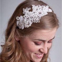 Wedding Headband idea--I like how the headband keeps hair out of the face, but its still a down style.