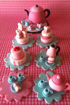 The set consists of 12 toppers. Made out of fondant. The teapot cake topper is optional. The price listed includes the teapot cake topper. If you