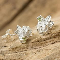 NOVICA Thailand Artisan Crafted Floral Silver and Peridot Earrings (€22) ❤ liked on Polyvore featuring jewelry, earrings, button, peridot, peridot jewelry, flower jewelry, novica earrings, handcrafted silver jewelry i sparkly earrings