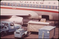 that's a dog on the baggage belt of the United (737?) FriendShip; Portland OR, May 1973