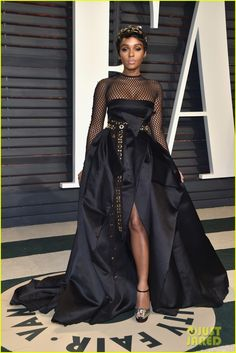 2017 Oscars: Janelle Monae wore a black Alexandre Vauthier gown with long sleeve netting and a belt with grommets. Janelle always pushes the envelope on the red carpet! This dress is very edgy and fun!
