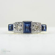 (http://www.addysvintage.co.uk/1930s-five-stone-engagement-ring-alternating-rectangular-step-cut-blue-synthetic-sapphires-diamonds-in-18-carat-platinum/)