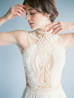 Dramatic Illusion Lace Wedding Dress  Definitely need some sort of slip underneath but love the embellishments.