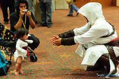 OMFG! Cutest thing ever. An Assassin with a baby assassin. :D  That baby was born within the hood. XD