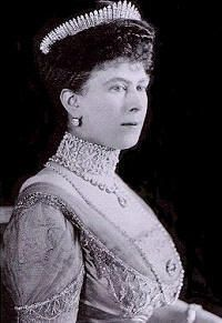 "Queen Mary's ""other"" Fringe tiara (which can also be worn as a necklace) is humpier in the middle and shorter on the sides then the better known fringe worn by the current Queen at her wedding, as well as longer and wrapping further around the head.  Some discussion whether this *is* the Queen Mary fringe or not – Mary was fond of altering her jewels frequently."