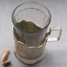 Soviet aluminium tea cup holder will suit standard soviet 250 ml glass. Please note the glass is not a part of the listing. The item was made in USSR