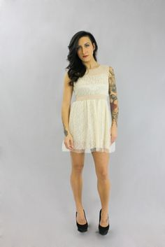 Put some flats on with this dress and you're ready for a daytime spring look! mishpish.com #lace #lacydress #sleevelessdress #whitedress #beige