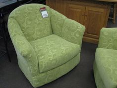 Pair of upholstered swivel-rocker club chairs with arms $170 each. Available in-store