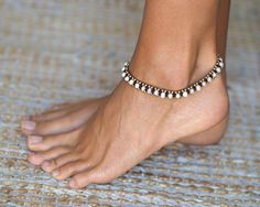 Pearl Shell Anklet ◀▶ Made out of waxed cotton, brass and Pearl Shell ◀▶ brass bell locket ▶ Anklet length is 25 cm long (10 inches). For more Anklets Click Here: https://www.etsy.com/shop/HagarTalmor?section_id=18541003 Feel free to contact me with any questions or requests Thank you ♥