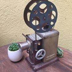 Very Rare ! 1920s vintage 35mm hand cranked junior movie projector, made in Japan.Incredibly this hand cranked projector was marketed and sold as a junior model in the late twenties!At that time, home movie viewing was becoming more and more popular and this projector was made for kids to share in the experience. This projector is made out of tin and has a manual crank handle that still turns. Condition: Some of the tin is bent just a little bit in places, but there aren't any major…
