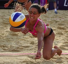Diving for an Olympics beach volleyball, Annie Martin from Canada plays against Team GB at Horse Guards Parade in London.  Photo: Petr David Josek - AP