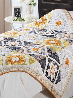 Part of the fun of working with a row quilt pattern is the secondary patterns that can appear. Fabric color and placement in this quilt creates a diagonal pattern even though it's assembled horizontally. Size: x Skill Level: Advanced Star Quilt Blocks, Star Quilts, Scrappy Quilts, Quilting Projects, Quilting Designs, Quilting Ideas, Sewing Projects, Bed Quilt Patterns, Star Patterns
