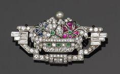 An art deco diamond, gem-set and platinum tutti frutti watch-brooch