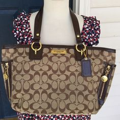 COACH Signature authentic handbag! Coach 100% authentic brown bag! Classic C design! Gold accents through out! The top zips shut! Excellent condition. Only gently used for a short time! Nice sized! Also I have the matching wallet in my closet! 14 inches across 9 inches deep!! Coach Bags