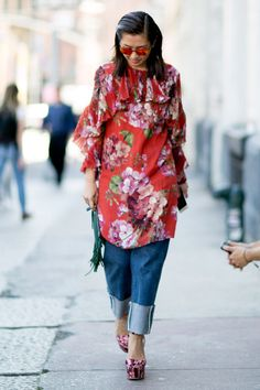 Red floral dress worn over jean with platform heels.