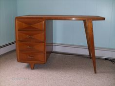 Elegant and graceful desk by Gio Ponti.