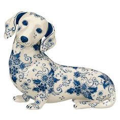 Porcelain Dachshund sculpture decorated in the classic Blue Delft style