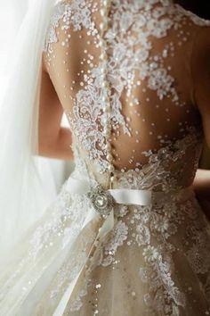 ivory lace wedding dresses, pearl decor for bridal dress, winter wedding idea www.dreamyweddingideas.com