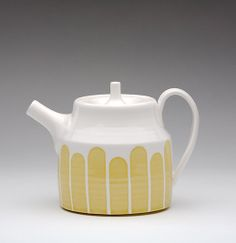 This wheel-thrown yellow striped teapot is made and glazed by hand! After throwing all the parts on the potters wheel, the foot is carefully trimmed and spout is attached with straining holes on the inside so your tea doesn't get stuck in the spout.Each stripe is created using hand-cut stencils that mask off the glaze design while the white part of the teapot is glazed.  After using wax resist to protect the white glazed parts, I peel away the stencils, clean everything up and t...