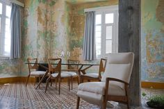 Image 2 of 6. Conceptual artist Wilfredo Prieto's apartment. Prieto's work often involves engineering, and he knocked down interior walls but preserved the mottled paint of this space. Image Courtesy of Hannah Berkeley Cohen via Curbed