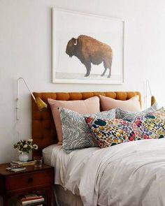 Masterfully mixed printed pillows perfectly balance against these white walls.