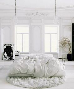 Bed in middle of room http://www.sijalica.com/interior/young-designers-paris-apartment/