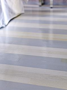 hardwood floors painted with a two-tone paint treatment using porch and deck paint and a high-gloss sealer. On a deck? Painted Hardwood Floors, Timber Flooring, Wall Carpet, Bedroom Carpet, Stair Carpet, Red Carpet, Wood Box Centerpiece, Sophisticated Bedroom, Wood Beds