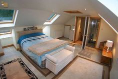Window nooks on either side of bed nice with double velux for more light