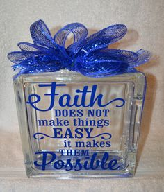 This is a beautiful Glass Block 8x8x3 featuring Faith does not make things EASY it makes them POSSIBLE in vinyl accented with Blue mesh ribbon. The price shown is for the block as it is shown here, ho