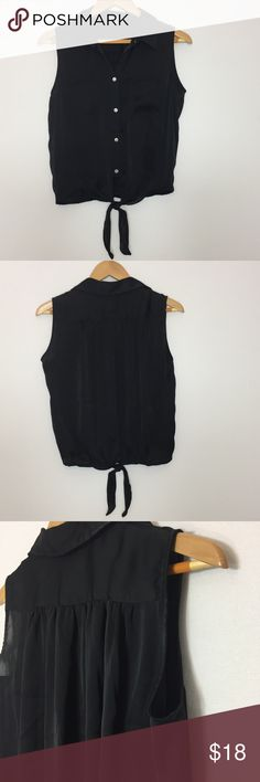 """Vince Camuto Button Sleeveless Front Tie Blouse S Very nice silky soft button down sleeveless top.  EUC.  All buttons in tact.  Two front top pockets.  Nice front tie to give the top a bit of character.  Can dress up or dress down.  Please ask questions and view all photos. Material: 100% Polyester Approximate Measurements:  Bust-19.5"""" Length-22""""  Add to a bundle and save.   (A36-580-1217) Vince Camuto Tops Blouses"""