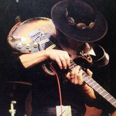 Stevie Ray Vaughan playing guitar in the usual way. Stevie Nicks Concert, Stevie Ray Vaughan Guitar, William Christopher, David Gilmour, Robert Plant, Keith Richards, Def Leppard, Jim Morrison, Eric Clapton