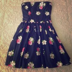 Abercrombie dress Worn once! In amazing condition. Strapless navy blue with floral pattern. Contains tie around piece. Stretchy in the back. Very short. Abercrombie & Fitch Dresses