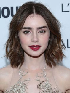 If your hair is above shoulder length, you can still wear it down and look prom-worthy with Lily's loose waves! Spritz your hair with sea salt spray for extra texture, then blow dry your strands with a round brush. Use a 3/4 inch curling iron to create loose waves, separating the curls with your fingers after they cool. Finish with a healthy dose of flexible hairspray. MORE: Best Short Haircuts Of All Time!