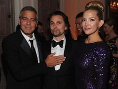 Is Matt Bellamy a little nervous about George Clooney getting handsy with him?The handsome Muse frontman poses with his gorgeous fiancee Kate Hudson and the two-time People's Sexiest Man Alive while at the White House Correspondents' Dinner on April 28.