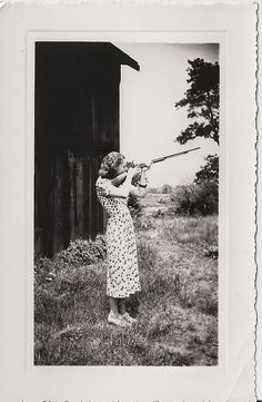 30 Interesting Vintage Photographs of Women Posing with Guns