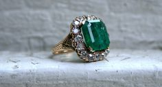 Im so in LOVE with this Awesome Massive Antique Diamond and Emerald Halo Ring - its just stunning! And despite the current popularity of the halo