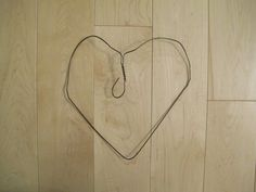 Bend the wire hanger into a heart shape to form your wreath base. Wreath Hanger, Heart Wreath, Diy Network, Wire Hangers, Christmas Angels, Pine Cones, Rustic Decor, Heart Shapes, Helpful Hints