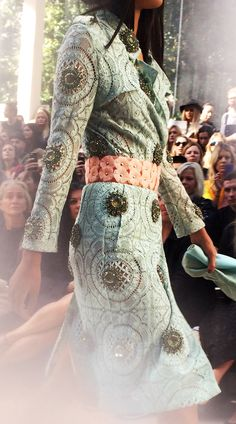 Pale mint English lace trench coat embellished with hand-sewn gemstone motifs on the runway. Handmade to order from Burberry.com until 30 September 2013