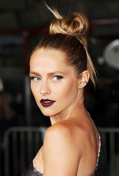Teresa Palmer nails this beauty look with bronzed, glowing skin, vampy lips and a big bun with a few statement-making strands