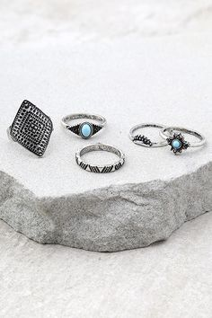 Wear the Down the Coast Blue and Silver Ring Set wherever your travels take you! This cute set features five antiqued silver rings with designs ranging from blue charms, to simple engraved bands.