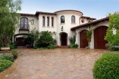 white Spanish style home... it could use some blue mosaic tile