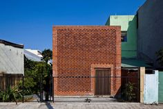 The passively-cooled Termitary House in Vietnam has a skin, made from orange red-bricks, allows breeze and light to penetrate the interior of the house and create wonderful ambiances, while protecting against wind and rain.