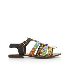Lush boho embellishments make the Lalita flat sandal a must-have. Embroidery, charms, pompoms and chains adorn the front leather straps, with an adjustable ankle strap for comfortable wear. Style the Lalita with boyfriend jeans and preppy oxford for eclectic off-duty cool.Material: VaqueroMade in India