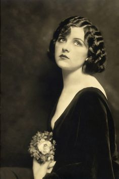 Eva Brady performed in the Ziegfeld Follies of 1920, 1921 and 1922. She was also known as Eva Grady (her married name)