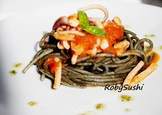 Spaghetti al nero di seppia con pomodoro, basilico e calamari! You can find the recipe here: http://robysushi.com/2014/04/07/5-ingredienti-5-mosse-una-ricetta-spaghetti-al-nero-di-seppia-con-pomodoro-basilico-e-calamari/  try it!!!