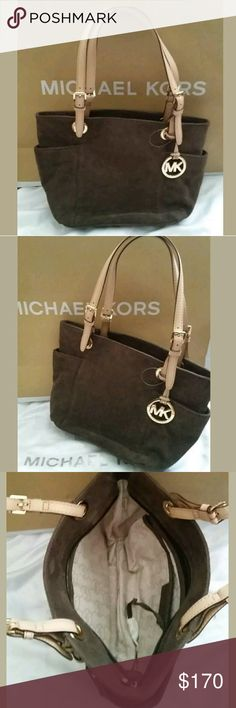 """$250 NEW Michael Kors Brown Mocha Suede Tote Bag NEW AUTHENTIC MICHAEL KORS BROWN SUEDE LEATHER  New without tags  SUEDE & LEATHER  Color: Browns  Bag Length: 13""""  Bag Height: 9""""  Strap Drop: 9""""  Bag Depth: 4.5""""  Msrp: $250  Absolutely stunning in person,  very rare to find, and worth every penny! Perfect for Summer,  Fabulous for Fall,  and priced for everyone! Overall a GREAT DEAL!  Leather is a Natural Product and has distinctive creases, not to be considered defects but the natural…"""