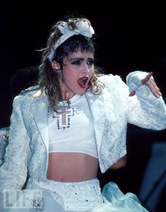 Like a Virgin  Madonna wears white and makes the Christian cross a fashion statement.